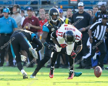 Jacksonville Jaguars defensive back Sherrod Martin, left, and cornerback Will Blackmon (24) break up a pass intended for Atlanta Falcons wide receiver Devin Hester (17) during the first half of an NFL preseason football game in Jacksonville, Fla