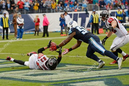 Avery Williamson, Jacob Tamme. Tennessee Titans linebacker Avery Williamson (54) intercepts a pass intended for Atlanta Falcons tight end Jacob Tamme (83) in the end zone in the second half of an NFL football game, in Nashville, Tenn