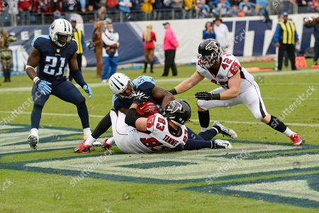 Avery Williamson, Jacob Tamme, Da'Norris Searcy, Patrick DiMarco. Tennessee Titans linebacker Avery Williamson (54) intercepts a pass intended for Atlanta Falcons tight end Jacob Tamme (83) in the end zone in the second half of an NFL football game, in Nashville, Tenn. At left is Titans safety Da'Norris Searcy (21) and at right is Falcons fullback Patrick DiMarco (42