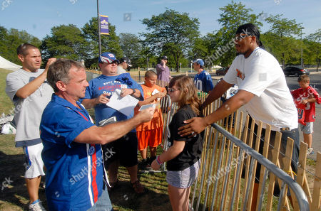 New York Giant William Beatty right, poses for a photograph with a fan at NFL football training camp in Albany, N.Y