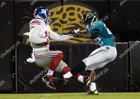 Stock Picture of Isaiah Stanback, Kevin Rutland. New York Giants receiver Isaiah Stanback, left, catches a touchdown pass in the end zone in front of Jacksonville Jaguars defensive back Kevin Rutland during the first half of an NFL preseason football game, in Jacksonville, Fla
