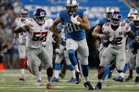 Joseph Fauria, Jacquian Williams, Jon Beason. Detroit Lions tight end Joseph Fauria (80) is pursued by New York Giants outside linebackers Jacquian Williams (57) and Jon Beason (52) during a 26-yard run during the third quarter of an NFL football game in Detroit