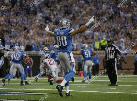 Detroit Lions tight end Joseph Fauria (80) celebrates a touchdown by Detroit Lions quarterback Matthew Stafford during the fourth quarter of an NFL football game against the in Detroit