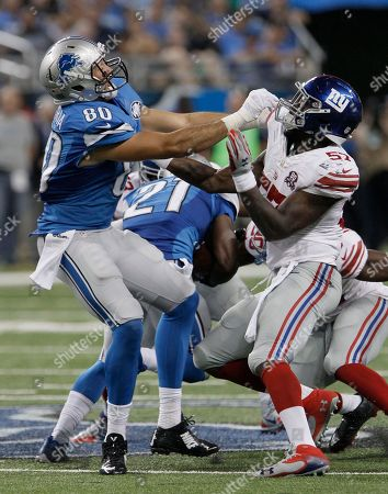 Joseph Fauria, Jacquian Williams. Detroit Lions tight end Joseph Fauria (80) tries to get past New York Giants outside linebacker Jacquian Williams (57) during the fourth quarter of an NFL football game in Detroit