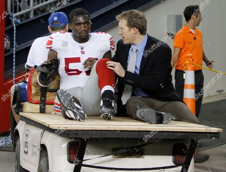 New York Giants linebacker Clint Sintim is carted from the field during the third quarter of a preseason NFL football game against the New England Patriots in Foxborough, Mass