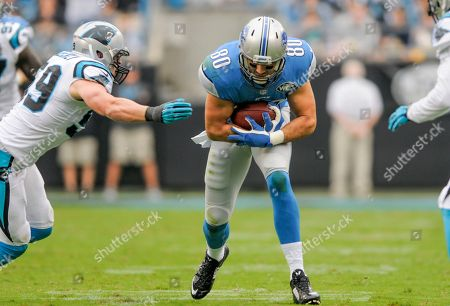 Detroit Lions tight end Joseph Fauria (80) runs the ball during an NFL football game against the Carolina Panthers in Charlotte, NC