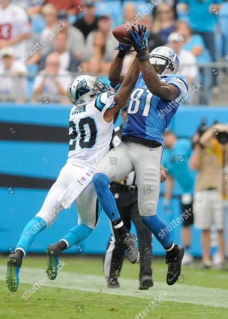 Antoine Cason, Calvin Johnson. Detroit Lions' Calvin Johnson (81) catches a pass as Carolina Panthers' Antoine Cason (20) defends during the first half of an NFL football game in Charlotte, N.C