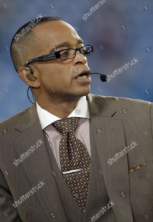 ESPN broadcaster Stuart Scott on set before an NFL football game featuring the New England Patriots against the Carolina Panthers in Charlotte, N.C., . The Panthers won 24-20