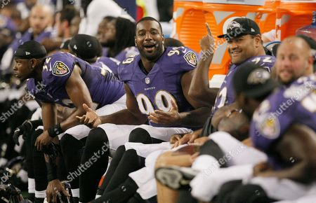 Baltimore Ravens defensive end Chris Canty (99) laughs with his teammates on the bench during the second half of an NFL preseason football game against the Dallas Cowboys, in Arlington, Texas. The Ravens won 37-30