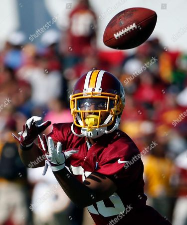 Washington Redskins cornerback Richard Crawford makes a catch during practice at the team's NFL football training facility, in Richmond, Va