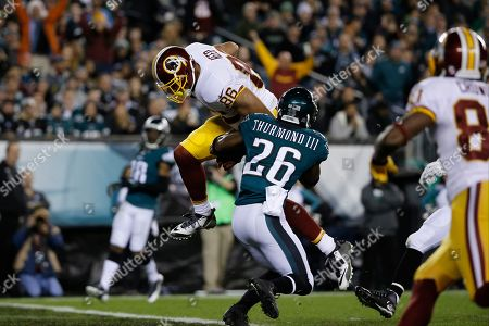 Stock Image of Washington Redskins' Jordan Reed, left, scores a touchdown past Philadelphia Eagles' Walter Thurmond in the first half of an NFL football game, in Philadelphia