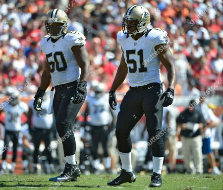 New Orleans Saints linebacker Jonathan Vilma (51) and teammate middle linebacker Curtis Lofton wait for a play against the Tampa Bay Buccaneers during the second quarter of an NFL football game, in Tampa, Fla