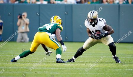 New Orleans Saints' Josh Morgan catches a pass in front of Green Bay Packers' Quinten Rollins during the first half of an NFL preseason football game, in Green Bay, Wis