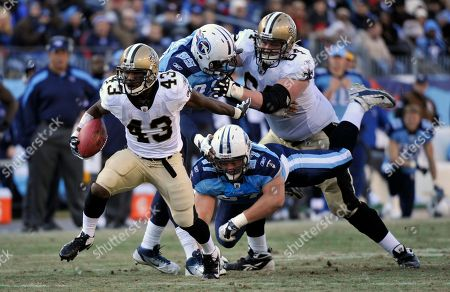 Darren Sproles, Lavelle Hawkins, William Hayes. New Orleans Saints running back Darren Sproles (43) runs past Tennessee Titans defenders Lavelle Hawkins (87) and William Hayes (95) in the fourth quarter of an NFL football game, in Nashville, Tenn. The Saints won 22-17