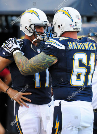Philip Rivers, Nick Hardwick. San Diego Chargers quarterback Philip Rivers (17), left, talks with Nick Hardwick (61) before a pre-season NFL football game against the Seattle Seahawks at Qualcomm Stadium in San Diego