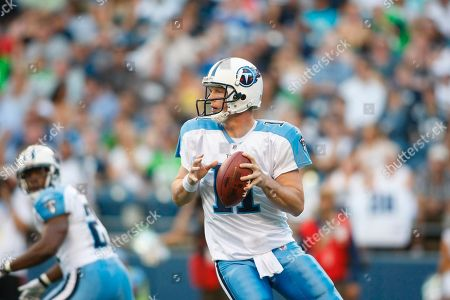 Tennessee Titans' Chris Simms looks to pass in the first half of an NFL preseason football game, in Seattle