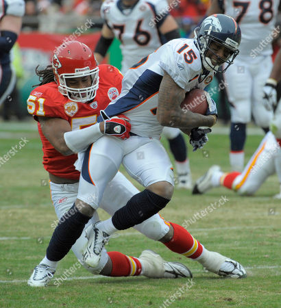 Corey Mays, Brandon Marshall. Denver Broncos wide receiver Brandon Marshall (15) is tackled by Kansas City Chiefs linebacker Corey Mays (51) during the first half of an NFL football game against the Kansas City Chiefs in Kansas City, Mo