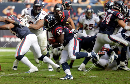 Houston Texans running back Deji Karim (39) carries the ball against the Denver Broncos during the third quarter of an NFL football game, in Houston