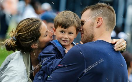 Tom Brady, Gisele Bundchen, Benjamin Brady. New England Patriots quarterback Tom Brady and his wife Gisele Bundchen embrace their son Benjamin Brady after a joint workout with the Tampa Bay Buccaneers at NFL football training camp, in Foxborough, Mass