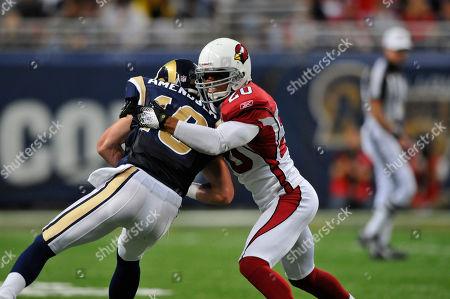 Ralph Brown, Danny Amendola. Arizona Cardinals cornerback Ralph Brown (20) tackles St. Louis Rams wide receiver Danny Amendola (16) during the third quarter of an NFL football game, in St. Louis. Arizona won 21-13