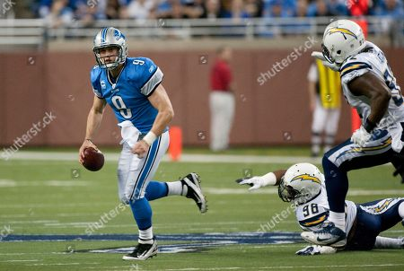 Matthew Stafford, Antwan Barnes, Vaughn Martin. Detroit Lions quarterback Matthew Stafford (9) scrambles away from San Diego Chargers outside linebacker Antwan Barnes (98) and defensive end Vaughn Martin (92) in the first half of an NFL football game, in Detroit