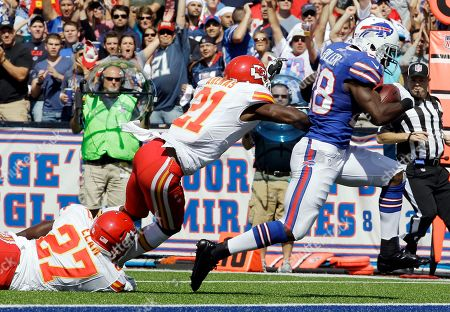 Stock Image of C. J. Spiller, Javier Arenas, Abram Elam. Buffalo Bills' C. J. Spiller (28) scores a touchdown under pressure from Kansas City Chiefs' Javier Arenas (21) and Abram Elam during the first quarter of an NFL football game in Orchard Park, N.Y
