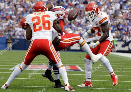 Stock Picture of Dorin Dickerson, Eric Berry, Abram Elam. Buffalo Bills' Dorin Dickerson (42) has the football ripped away after a tackle by Kansas City Chiefs' Eric Berry (29) and Abram Elam (27) during the first half of an NFL football game in Orchard Park, N.Y