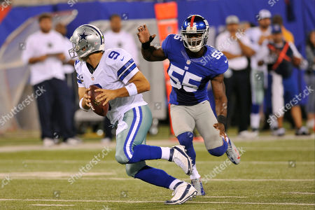 Keith Rivers, Tony Romo. New York Giants linebacker Keith Rivers (55) chases Dallas Cowboys quarterback Tony Romo (9) during the first half of an NFL football game, in East Rutherford, N.J