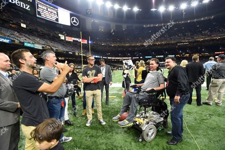 Former New Orleans Saints Steve Gleason poses for photos before an NFL football game against the Atlanta Falcons in New Orleans