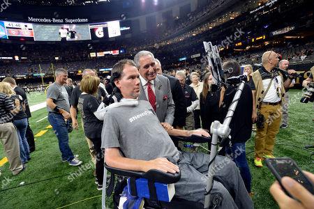 Steve Gleason, Arthur Blank. Former New Orleans Saints Steve Gleason poses for a photo with Atlanta Falcons owner Arthur Blank before an NFL football game in New Orleans