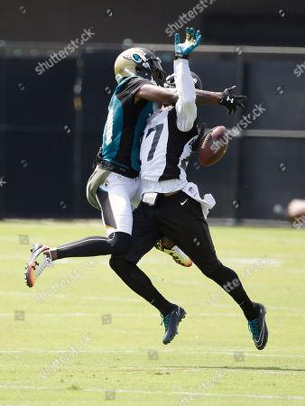 Marqise Lee, Dwayne Gratz. Jacksonville Jaguars cornerback Dwayne Gratz, right, breaks up a pass intended for wide receiver Marqise Lee, left, during an NFL football practice, in Jacksonville, Fla