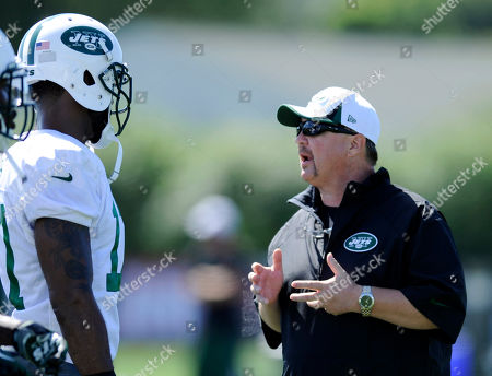 Stock Image of Marty Mornhinwe, Braylon Edwards. New York Jets offensive coordinator Marty Mornhinweg, right, talks with wide receiver Braylon Edwards at their NFL football training camp, in Cortland, N.Y