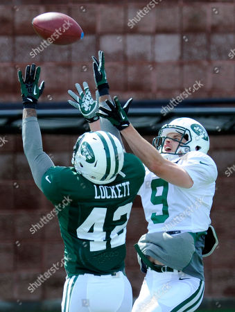 Stock Image of Zach Rogers, Bret Lockett. New York Jets safety Bret Lockett, left, goes up to break up a pass intended for wide receiver Zach Rogers at their NFL football training camp, in Cortland, N.Y