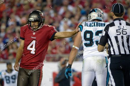 Rian Lindell, Chase Blackburn. Tampa Bay Buccaneers kicker Rian Lindell (4) pushes Carolina Panthers outside linebacker Chase Blackburn (93) after kicking a field goal during the first half of an NFL football game in Tampa, Fla