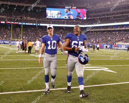 Eli Manning, William Beatty. New York Giants' Eli Manning, left, leaves the field with William Beatty after the NFL preseason football game against the New England Patriots at New Meadowlands Stadium in East Rutherford, NJ, . The Giants beat the Patriots, 20-17