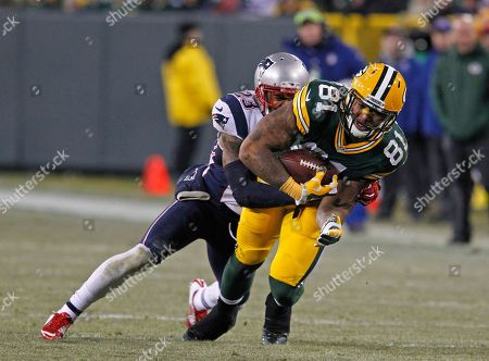 Andrew Quarless, Patrick Chung. Green Bay Packers tight end Andrew Quarless is hit after making a catch by New England Patriots strong safety Patrick Chung during an NFL football game, in Green Bay, Wis