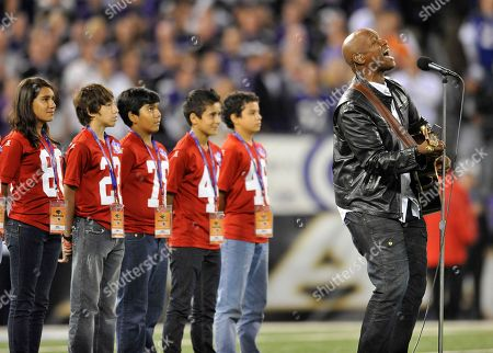 Stock Picture of Javier Colon performs the national anthem as part of the NFL's Hispanic Heritage Month before an NFL football game between the Baltimore Ravens and the New England Patriots in Baltimore