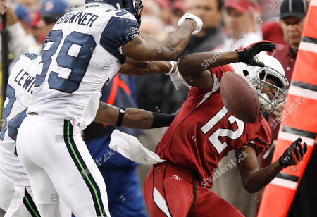 Andre Roberts, Brandon Browner, Roy Lewis. Arizona Cardinals wide receiver Andre Roberts (12) is knocked out of bounds by Seattle Seahawks cornerback Brandon Browner (39) and Roy Lewis during the first half of an NFL football game, in Tempe, Ariz