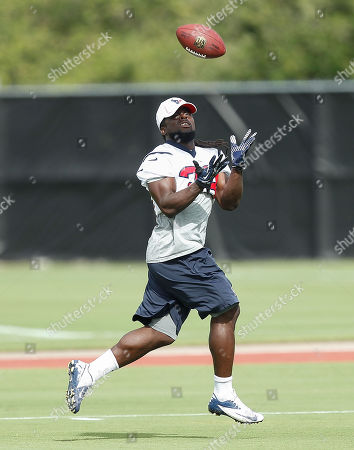 Houston Texans running back Deji Karim catches a pass during Houston Texans mini-camp, in Houston