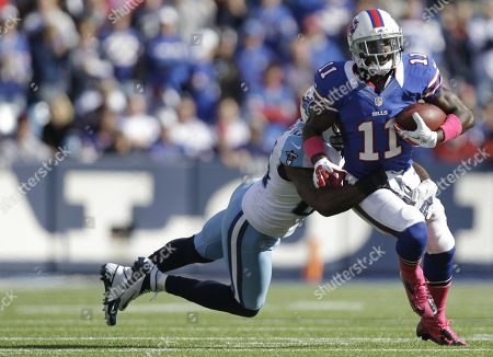 T.J. Graham, Jordan Babineaux. Buffalo Bills wide receiver T.J. Graham (11) runs under pressure from Tennessee Titans strong safety Jordan Babineaux (26) during the first half of an NFL football game in Orchard Park, N.Y