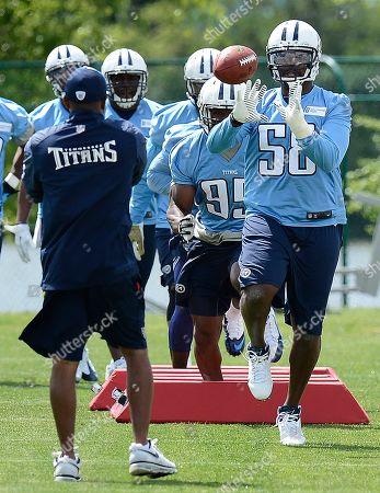 Tennessee Titans linebacker Shaun Phillips (58) catches the ball during an NFL football minicamp workout, in Nashville, Tenn