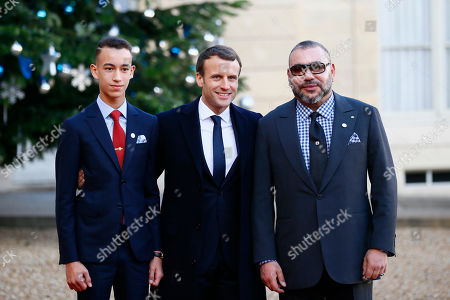 Morocco's Crown Prince Moulay El Hassan, left, and Morocco's King Mohammed VI, right, are welcomed by French President before a lunch at the Elysee Palace in Paris, . More than 50 world leaders are gathering in Paris for a summit that Macron hopes will give new momentum to the fight against global warming, despite U.S. President Donald Trump's rejection of the Paris climate accord