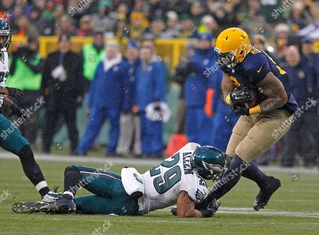 Andrew Quarless, Nate Allen. Green Bay Packers tight end Andrew Quarless (81) is hit after making a catch by Philadelphia Eagles strong safety Nate Allen (29) during an NFL football game, in Green Bay, Wis