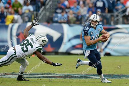Jake Locker, Antwan Barnes. Tennessee Titans quarterback Jake Locker (10) scrambles away from New York Jets linebacker Antwan Barnes (95) in the second quarter of an NFL football game, in Nashville, Tenn