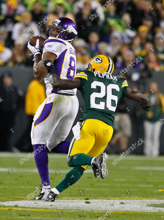 Visanthe Shiancoe Charlie Peprah. Minnesota Vikings tight end Visanthe Shiancoe catches a pass while being covered by Green Bay Packers strong safety Charlie Peprah during an NFL football game, in Green Bay, Wis