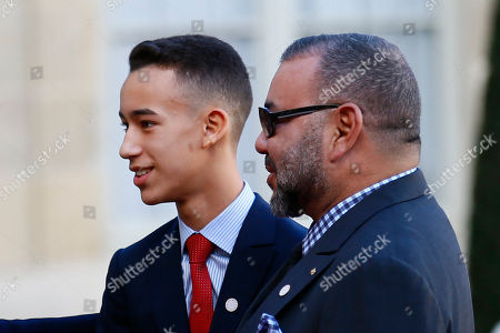 Stock Photo of Morocco's Crown Prince Moulay El Hassan, left, and Morocco's King Mohammed VI are welcomed by French President before a lunch at the Elysee Palace in Paris, . More than 50 world leaders are gathering in Paris for a summit that Macron hopes will give new momentum to the fight against global warming, despite U.S. President Donald Trump's rejection of the Paris climate accord