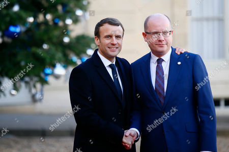 Stock Picture of Czech Republic's Prime Minister Bohuslav Sobotka is welcomed by French President Emmanuel Macron, left, before a lunch at the Elysee Palace in Paris, . More than 50 world leaders are gathering in Paris for a summit that Macron hopes will give new momentum to the fight against global warming, despite U.S. President Donald Trump's rejection of the Paris climate accord