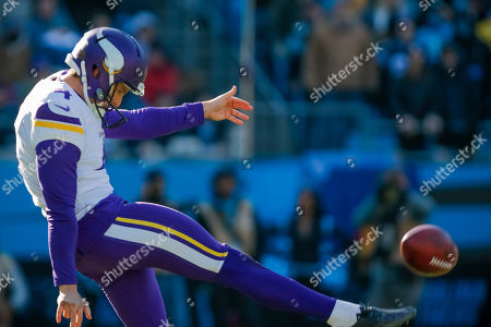 Minnesota Vikings' Ryan Quigley (4) punts to the Carolina Panthers during the first half of an NFL football game in Charlotte, N.C., . The Panthers won 31-24