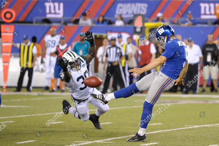 Zac Stacy, Steve Weatherford. New York Jets' Zac Stacy, left, attempts to block a punt by New York Giants Steve Weatherford during the first half of a preseason NFL football game in East Rutherford, N.J