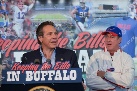 Andrew Cuomo, Mark Poloncarz. New York Gov. Andrew Cuomo speaks as Erie County Executive Mark Poloncarz, right, looks on before an NFL football game between the Buffalo Bills and the New England Patriots, in Orchard Park